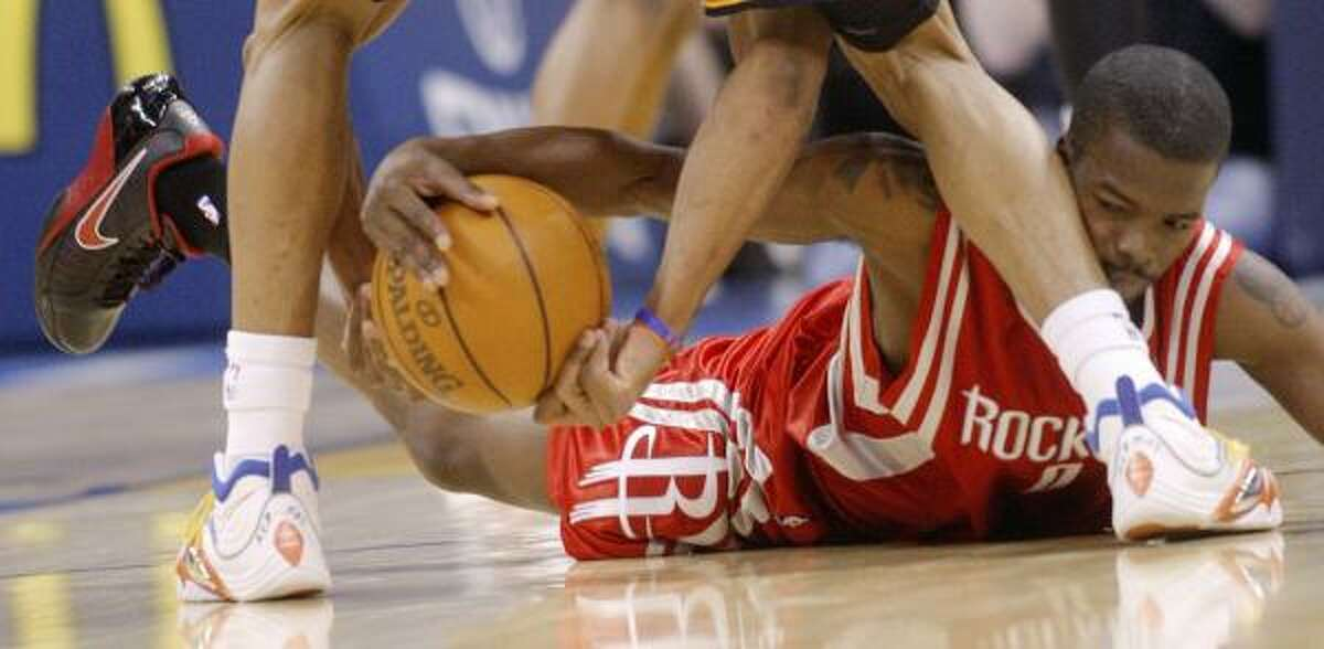 Rockets guard Aaron Brooks tries to take the ball away from Thunder guard Russell Westbrook.