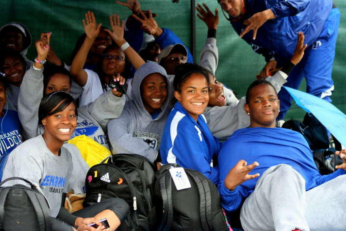 Dekaney's track team stays dry under their tent.