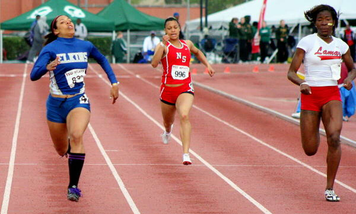 Elkins' Taylor Houston, left, North Shore's Raquel Sims, center, and Lamar's Blessing Mayungbe compete in the 200-meter run.