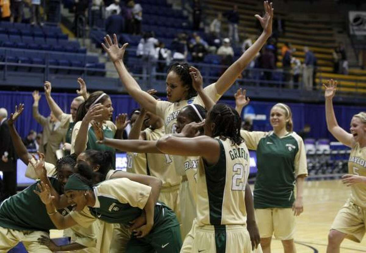Baylor basketball players, including Brittney Griner, who set a new NCAA Tournament block record, celebrate Baylor's 49-33 win over Georgetown Monday, Mar. 22.