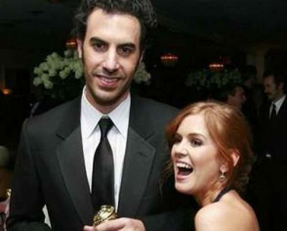 Sasha Baron Cohen and Isla Fisher reportedly got married after a six-year courtship. What other celeb couples are waiting to walk down the aisle? Photo: AP