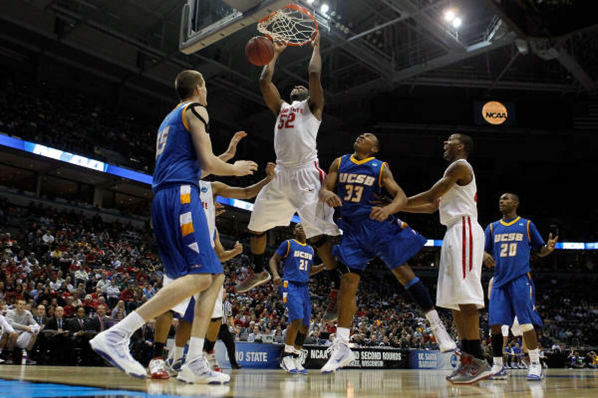March 19: No. 2 Ohio State 68, No. 15 UC Santa Barbara 51 Ohio State's Dallas Lauderdale slams home a dunk in the second half.
