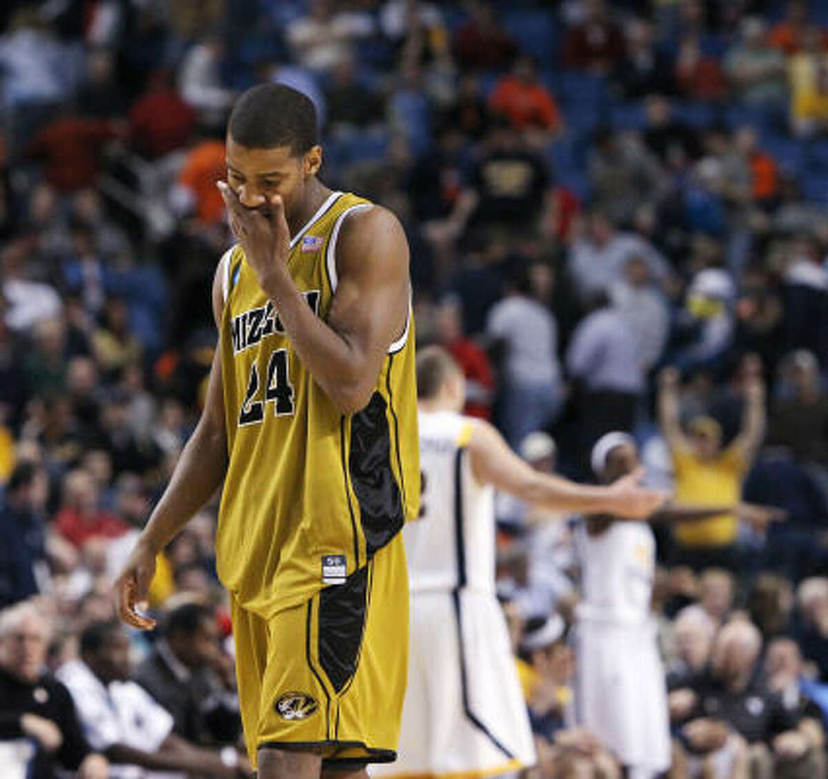 March 21: No. 2 West Virginia 68, No. 10 Missouri 59 Missouri guard Kim English walks off the court after losing to West Virginia 68-59.