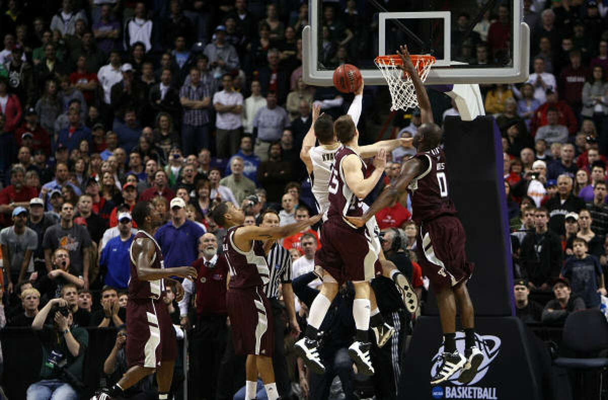 March 21: No. 4 Purdue 63, No. 5 Texas A&M 61 Purdue's Chris Kramer (3) shoots the game winning basket in overtime to defeat Texas A&M 63-61.