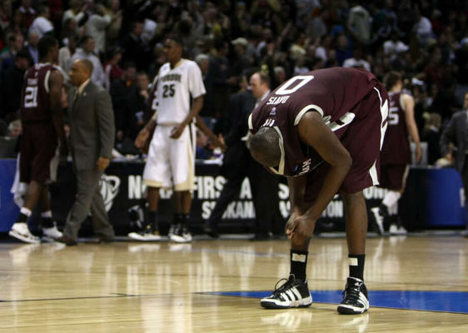 March 21: No. 4 Purdue 63, No. 5 Texas A&M 61Texas A&M Bryan Davis buries his head in his jersey after losing in overtime 63-61 to Purdue. Photo: Jonathan Ferrey, Getty Images