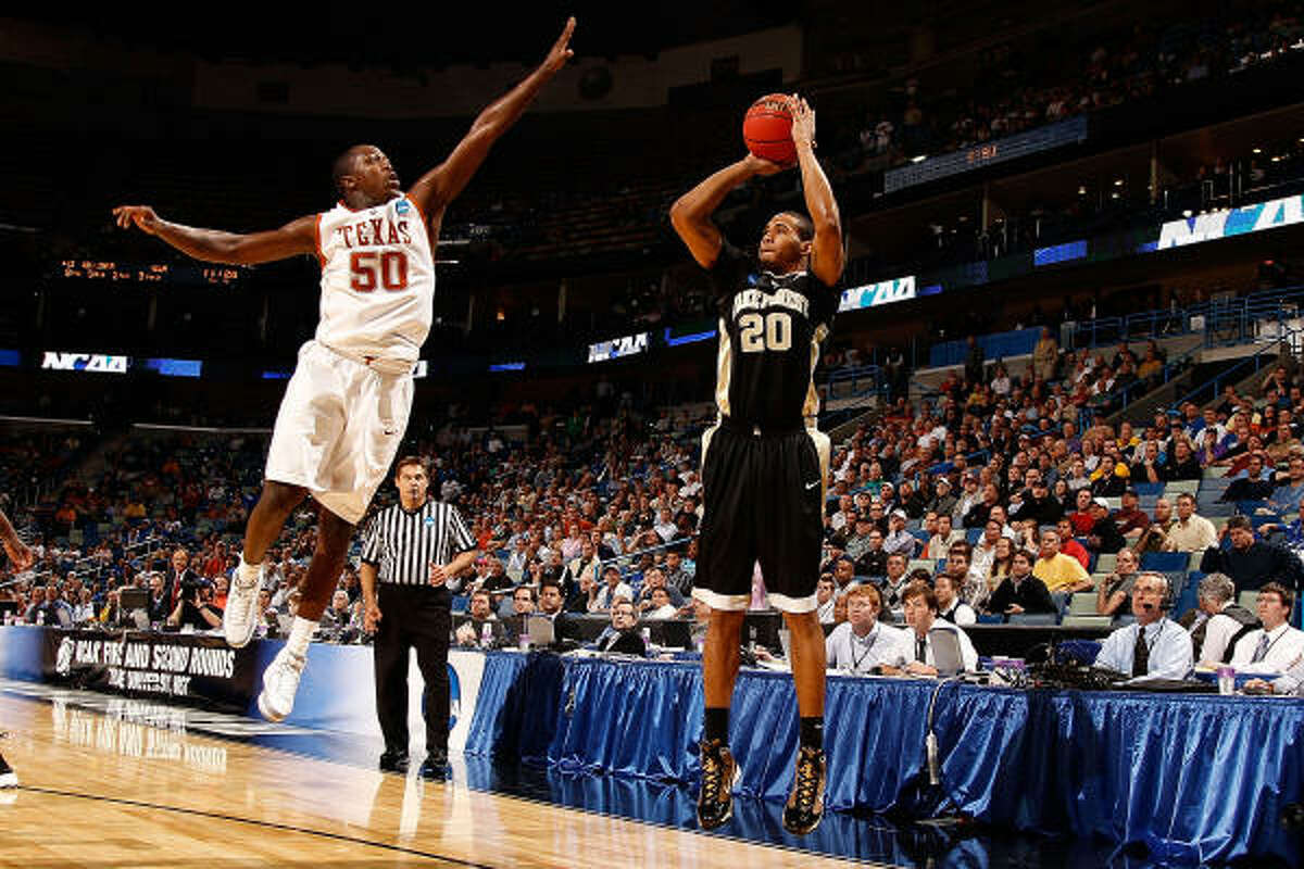 March 18: No. 9 Wake Forest 81, No. 8 Texas 80 (OT) Wake Forest's Ari Stewart, right, makes a shot over Texas' J'Covan Brown in overtime.