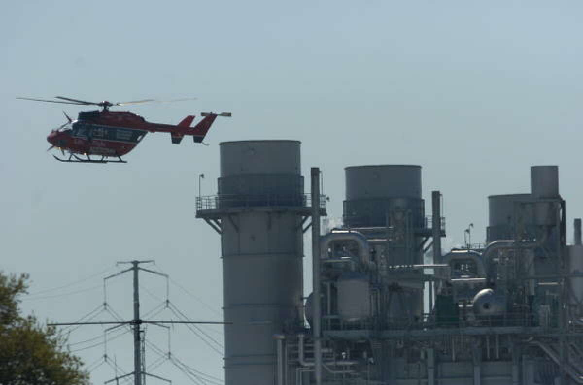 A Memorial Herman Life Flight helicopter flies near the BP plant on March 23, 2005.