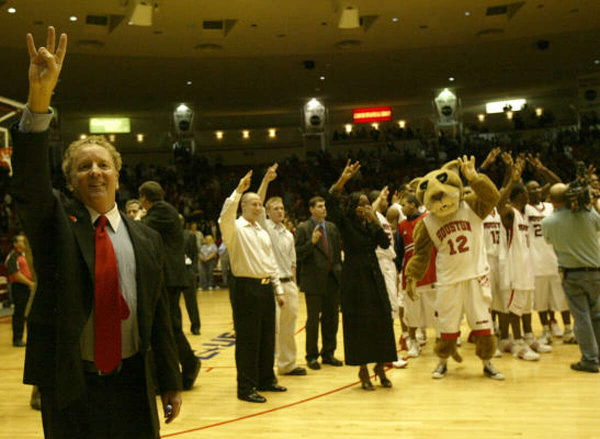 Penders sings the UH fight song after his team beat Louisville 70-67 in 2005.