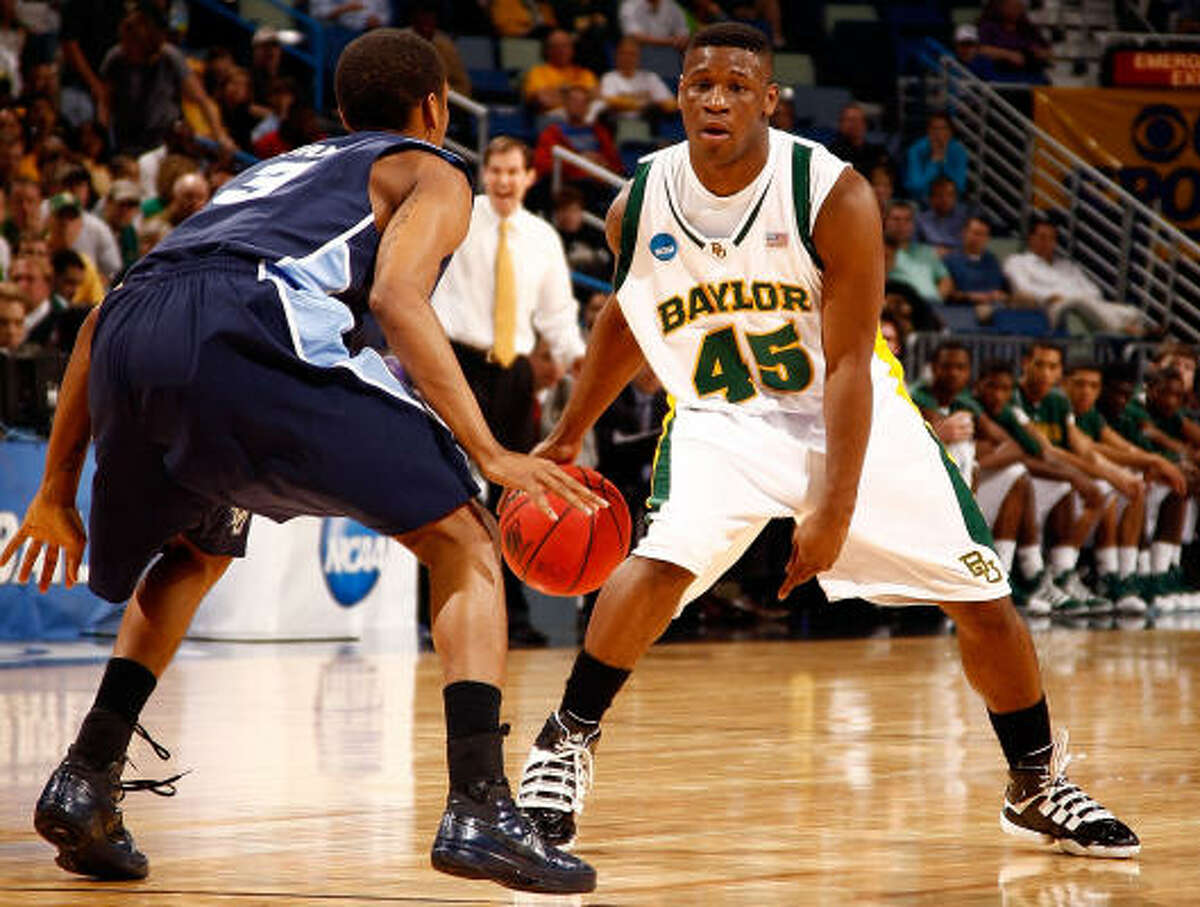 Baylor's Tweety Carter tries to drive around Old Dominion's Darius James during the Bears' win.