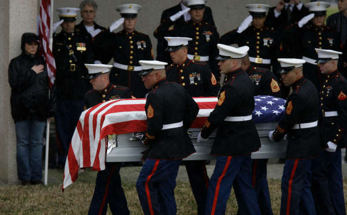 The casket of Marine Lance Cpl. Garrett Gamble is carried to service at Houston National Cemetery, 10410 Veterans Memorial Drive in Houston. He died March 11, 2010 died after stepping on a mine-type device while patrolling during combat operations in Helmand province in Afghanistan. He was 20.