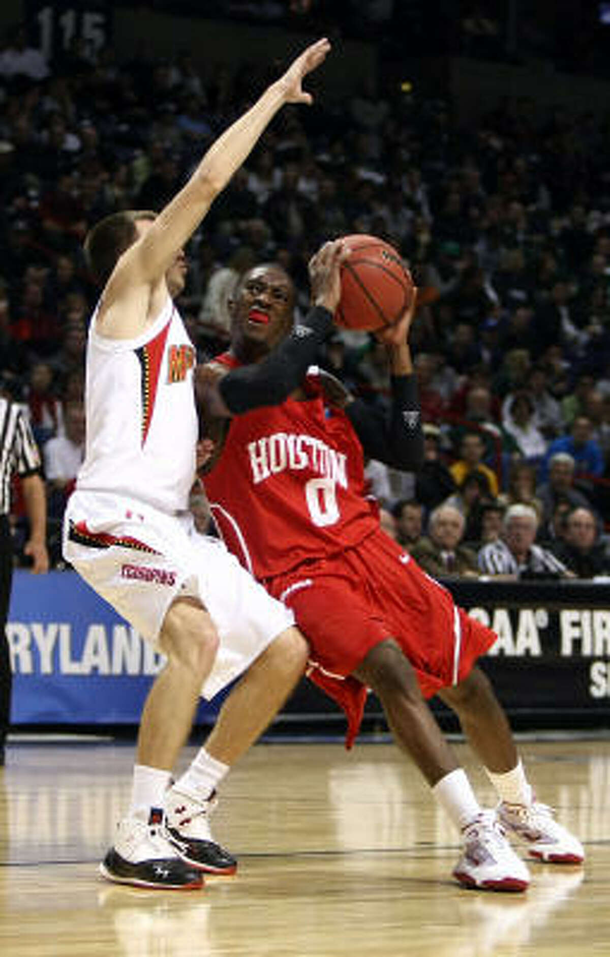 UH guard Kelvin Lewis, right, scored 24 points on 7-of-14 shooting.