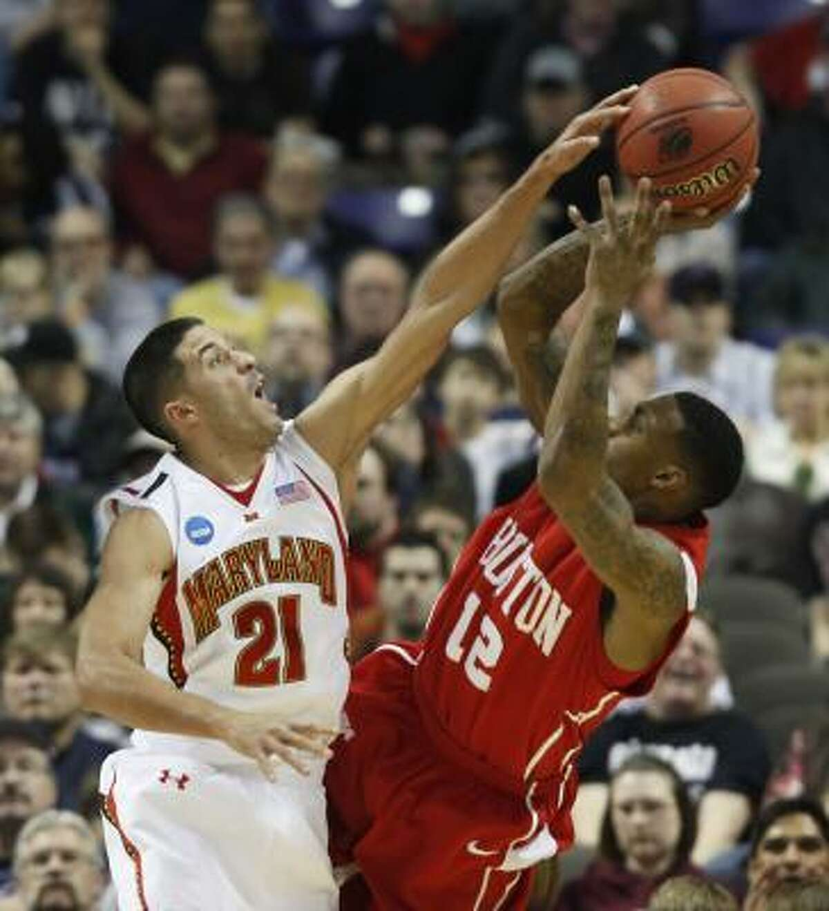 Maryland's Greivis Vasquez tries to block a shot by UH's Aubrey Coleman in the first half.