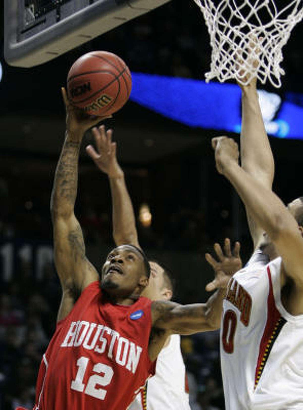 UH guard Aubrey Coleman puts up a shot as Maryland's Jordan Williams, right, tries to block it.