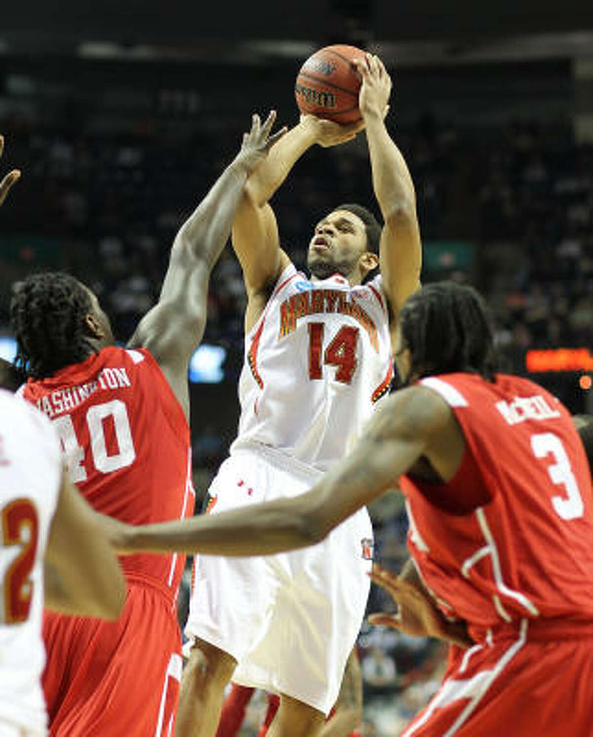 Maryland's Sean Mosley shoots over UH forward Kendrick Washington.