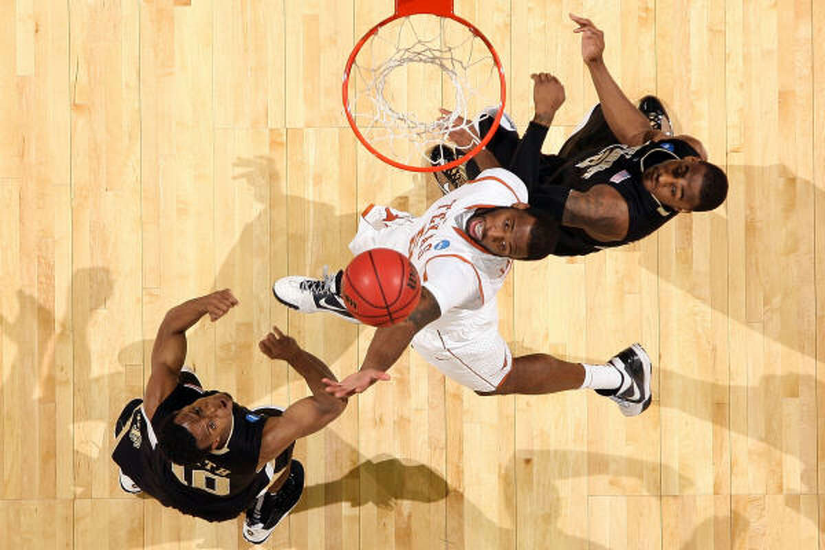 Texas forward Damion James, center, fights for a rebound with Wake Forest teammates Ishmael Smith, left, and L.D. Williams.