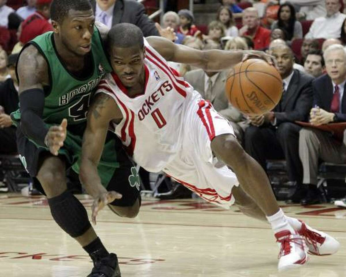 Rockets guard Aaron Brooks tries to drive toward the basket against Celtics guard Nate Robinson during the Rockets' loss at Toyota Center.