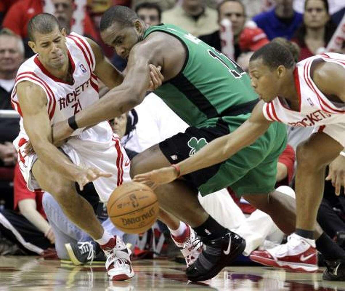 Rockets forward Shane Battier (31) and guard Kyle Lowry (7) battle Celtics forward Glen Davis (11) for a loose ball during the fourth quarter.