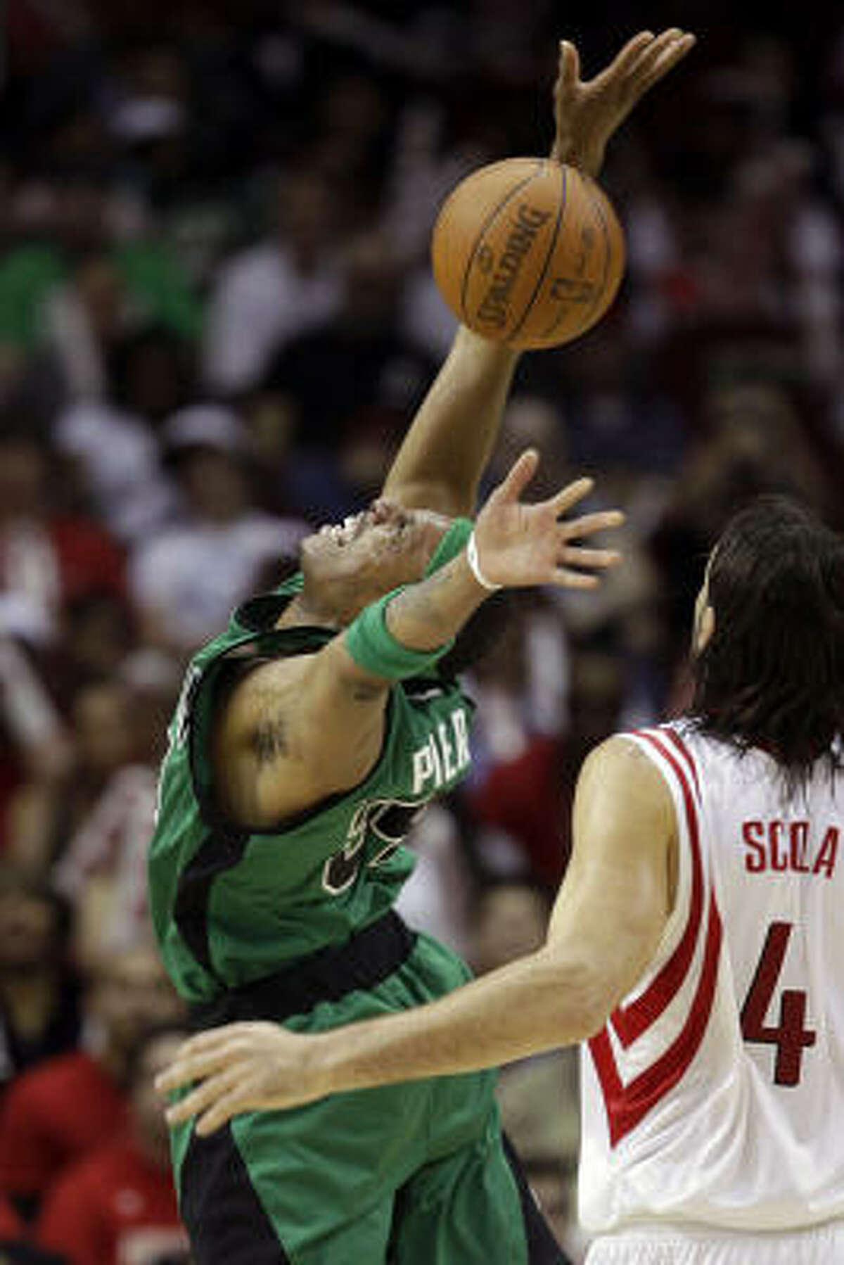 Celtics guard Paul Pierce loses the ball after being fouled by Rockets forward Luis Scola during the fourth quarter.