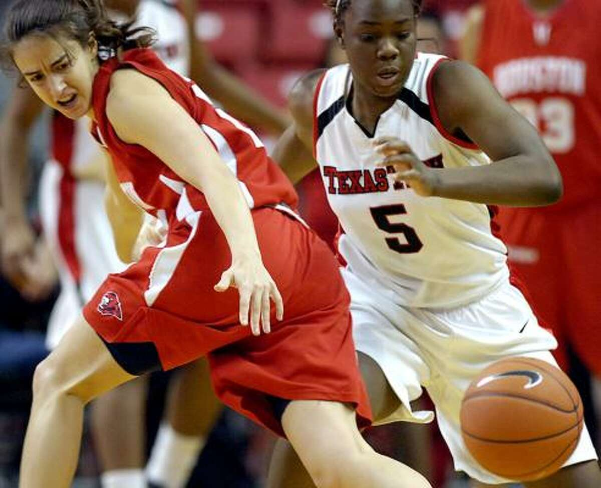 Texas Tech's Christine Hyde, right, steals the ball from Houston's Roxana Button.