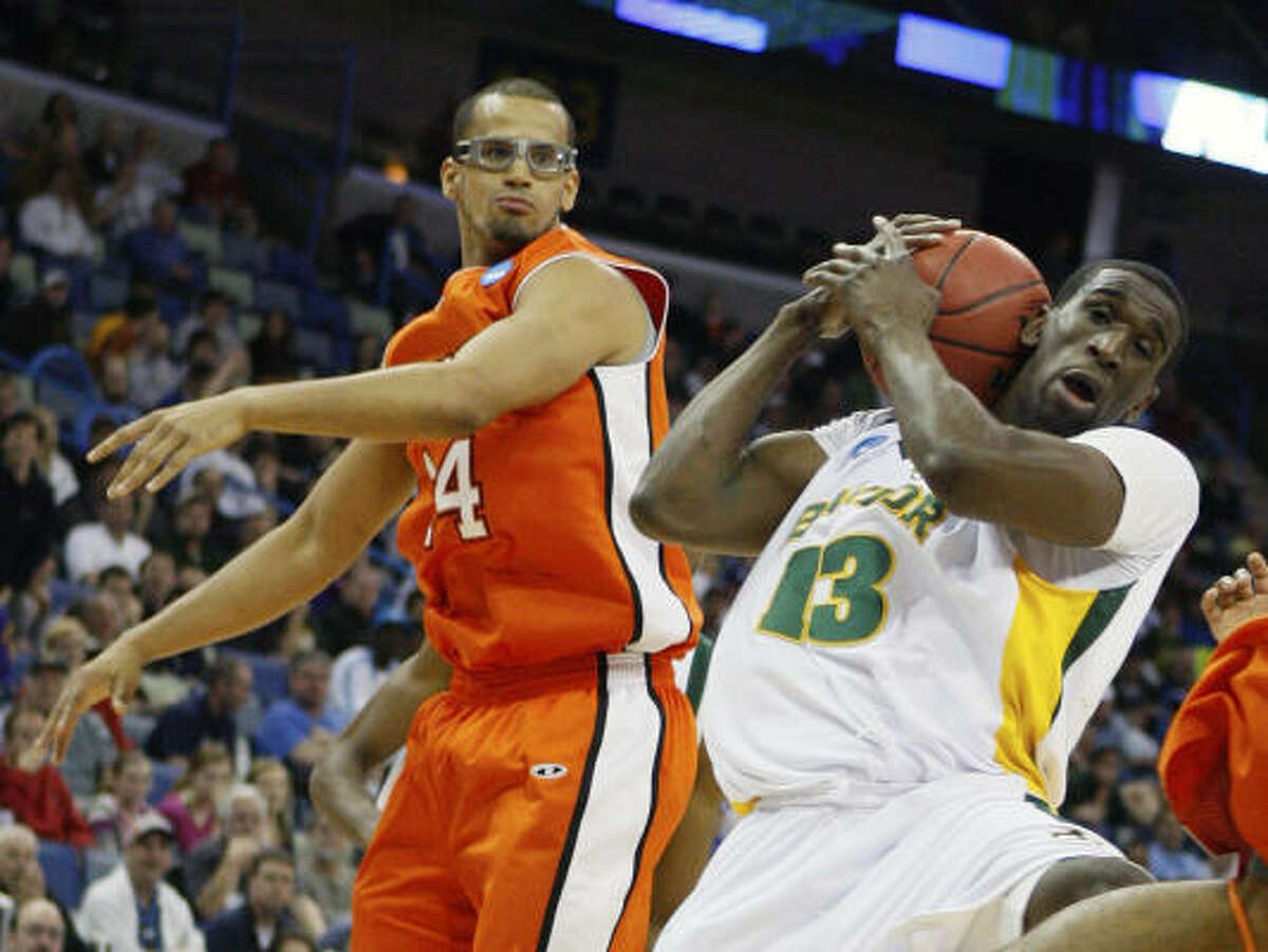 Baylor center Ekpe Udoh grabs a rebound in front of Sam Houston State forward Gilberto Clavell during Baylor's first-round win.