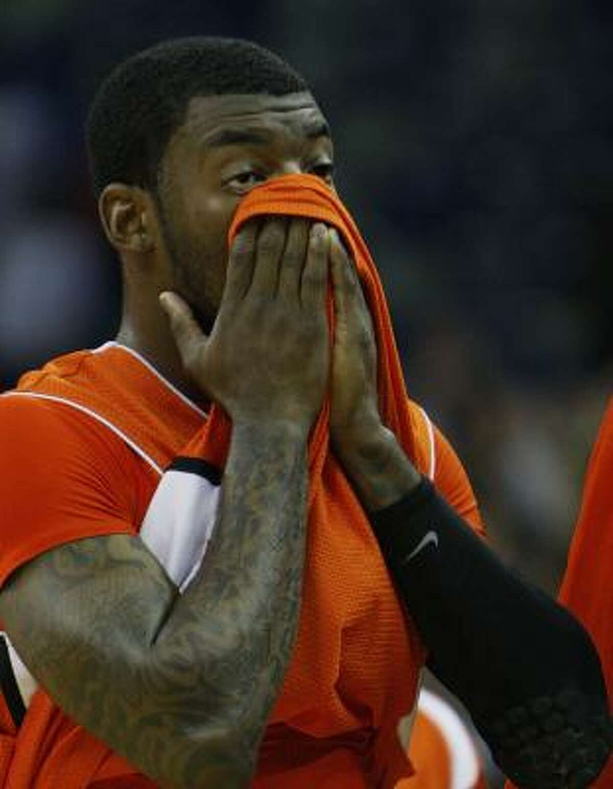 Sam Houston State guard Corey Allmond walks off the court after the loss.