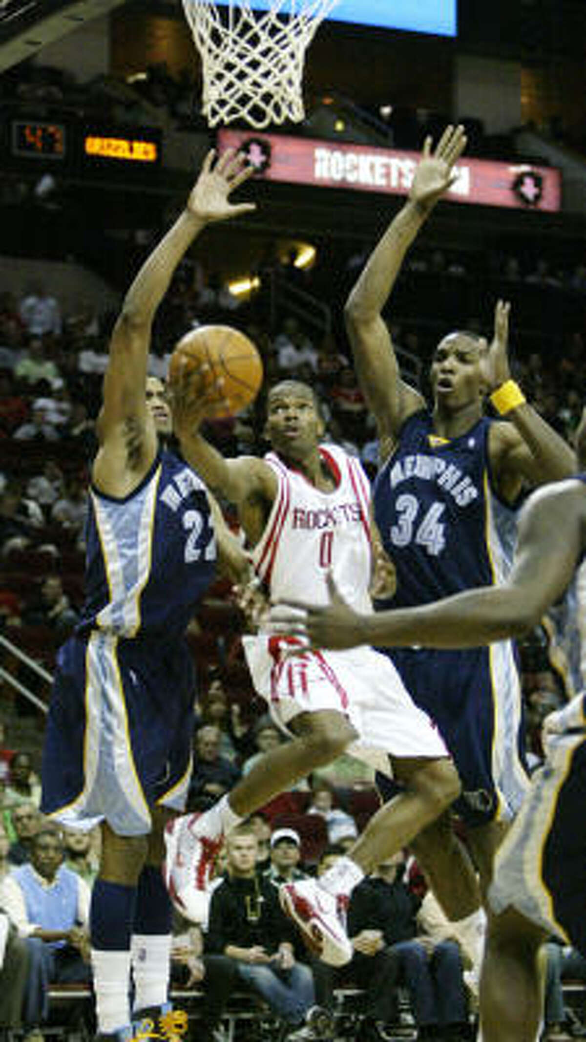 Rockets guard Aaron Brooks, center, goes up for a lay up in traffic. Brooks had his second-consecutive 31 point outing in the Rockets 107-94 win over the Memphis Grizzlies.
