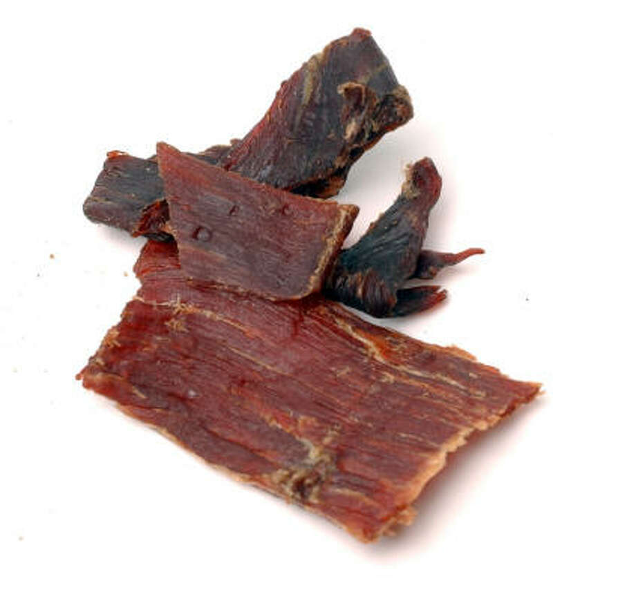 For the low-carb dieter, sausage and jerky may seem like a good choice, but they contain large amounts of saturated fat and trans-fats. One ounce of jerky contains: Calories: 70; Calories From Fat: 10; Total Fat: 1g; Total Sugar: 4g. A way to get protein is to opt for something healthier, like peanuts. Photo: JUANITO GARZA, San Antonio Express-News