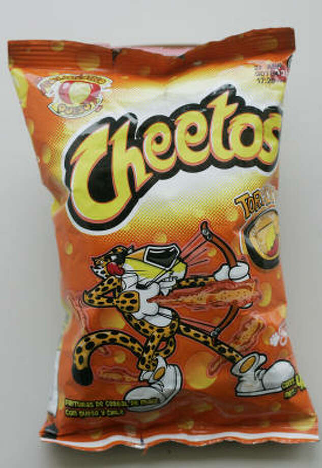 Now for what you should eat: For anyone who just can't keep away from the cheesy taste of Cheetos, there is a baked version. One ounce contains: Calories From Fat: 45; Total Fat: 5g. They are just as crunchy and hopefully, just as satisfying. Photo: CINDY YAMANAKA, MCT