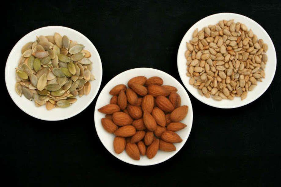 "Peanuts, almonds, cashews--they are all good sources of protein and contain monounsaturated fat, which may help lower cholesterol. One cup of almonds contain: Protein: 6g; Total Fat: 5g. Try to find roasted or raw types of nuts, the heavily salted or ""honey roasted"" aren't as healthy. Photo: Szasz-Fabian Jozsef, Fotolia"