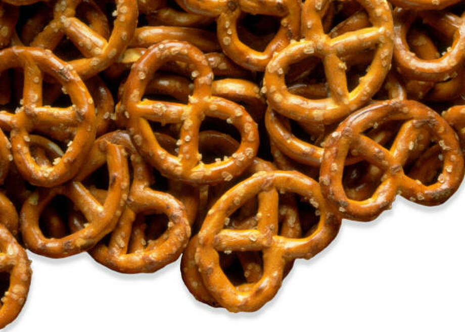 Pretzels are much better than a bag of chips because they don't contain fat, but can be just as satisfying. One ounce of Rold Gold sticks contain: Calories: 100; Calories From Fat: 0; Total Fat: 0g. As long as they aren't eaten in excess, pretzels make for a good snack, without the added sugar, either.