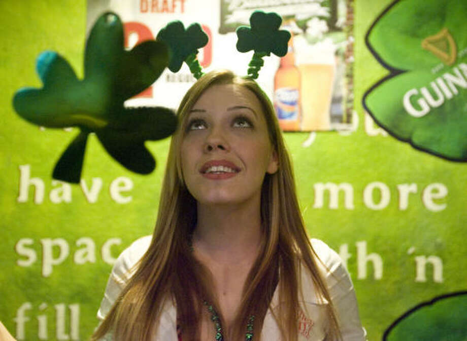 Tilted Kilt Pub & Eatery, manager Danielle Miller decorates the walls of the bar with shamrocks. Take a look at how some folks celebrated.