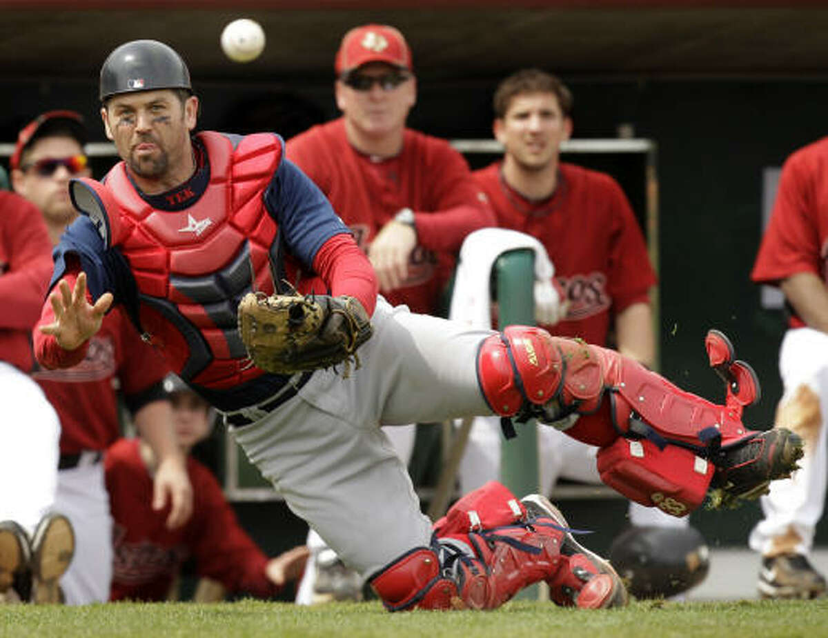 Boston Red Sox catcher Jason Varitek throws to pitcher Jon Lester at the plate after retrieving a wild pitch during the fourth inning. Lester gave up three hits, two walks and one run in four innings.