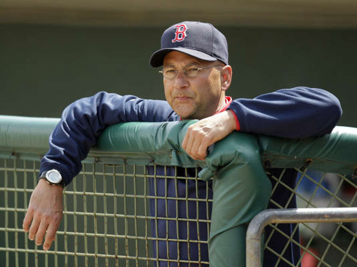 Red Sox manager Terry Francona watches from the dugout.
