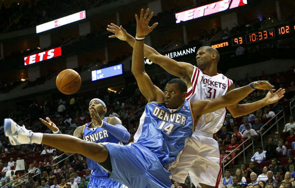 Rockets guard Shane Battier battles with Nuggets guard Joey Graham for possession.