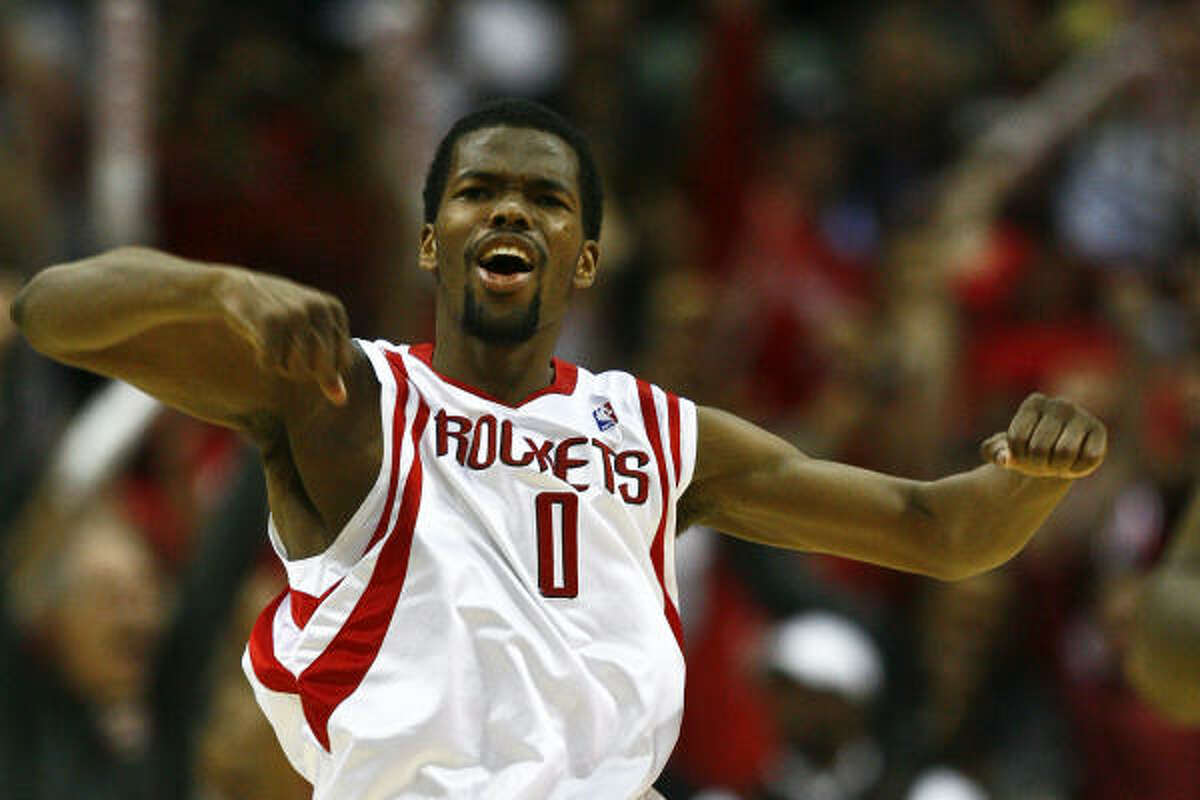 Rockets guard Aaron Brooks celebrates after hitting the game-winning shot.