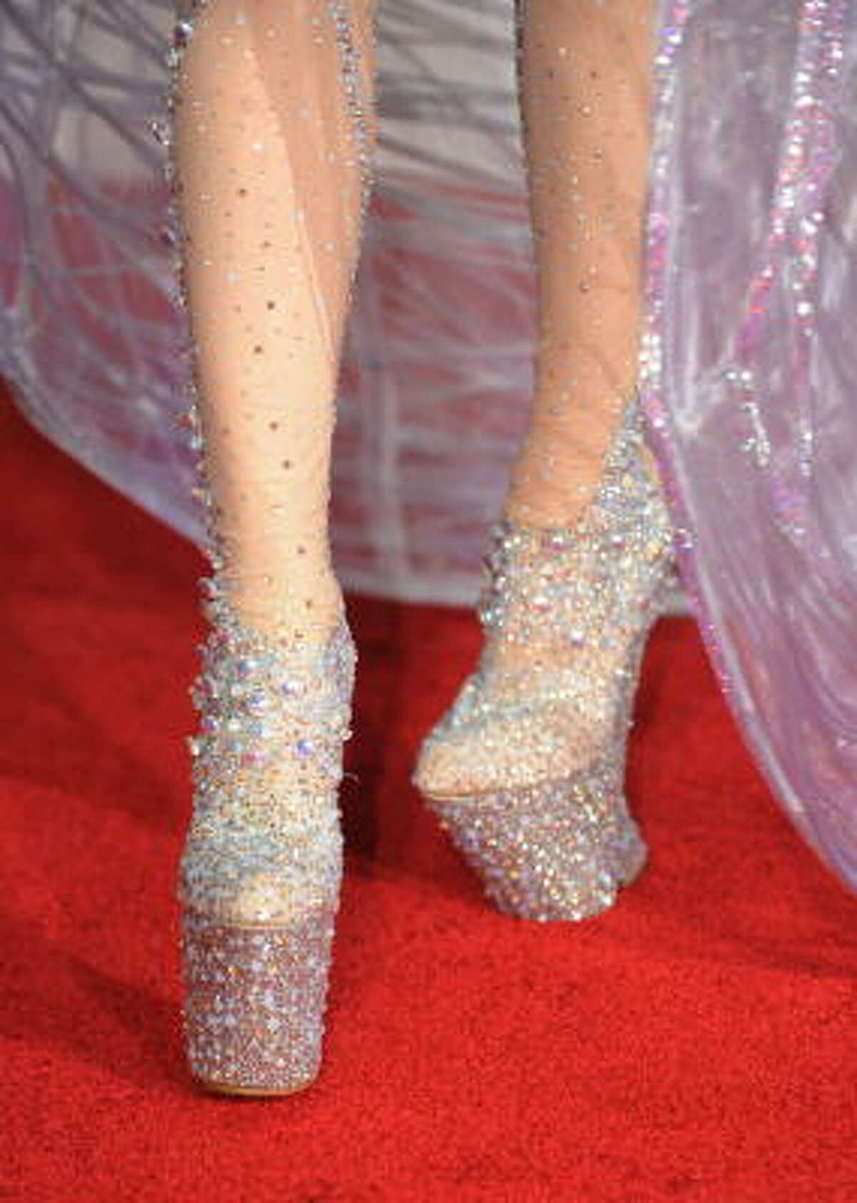 Even her shoes are over the top.