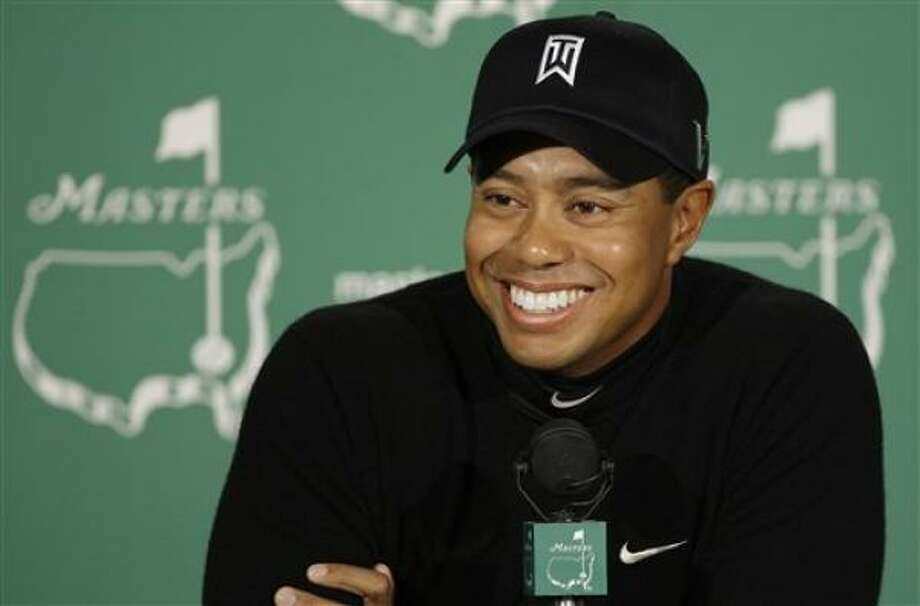 """Tiger Woods, seen in April 2009, issued a statement Tuesday, March 16, saying he would return to golf. """"The Masters is where I won my first major and I view this tournament with great respect,"""" Woods said in a statement. """"After a long and necessary time away from the game, I feel like I'm ready to start my season at Augusta."""" Photo: Chris O'Meara, AP"""