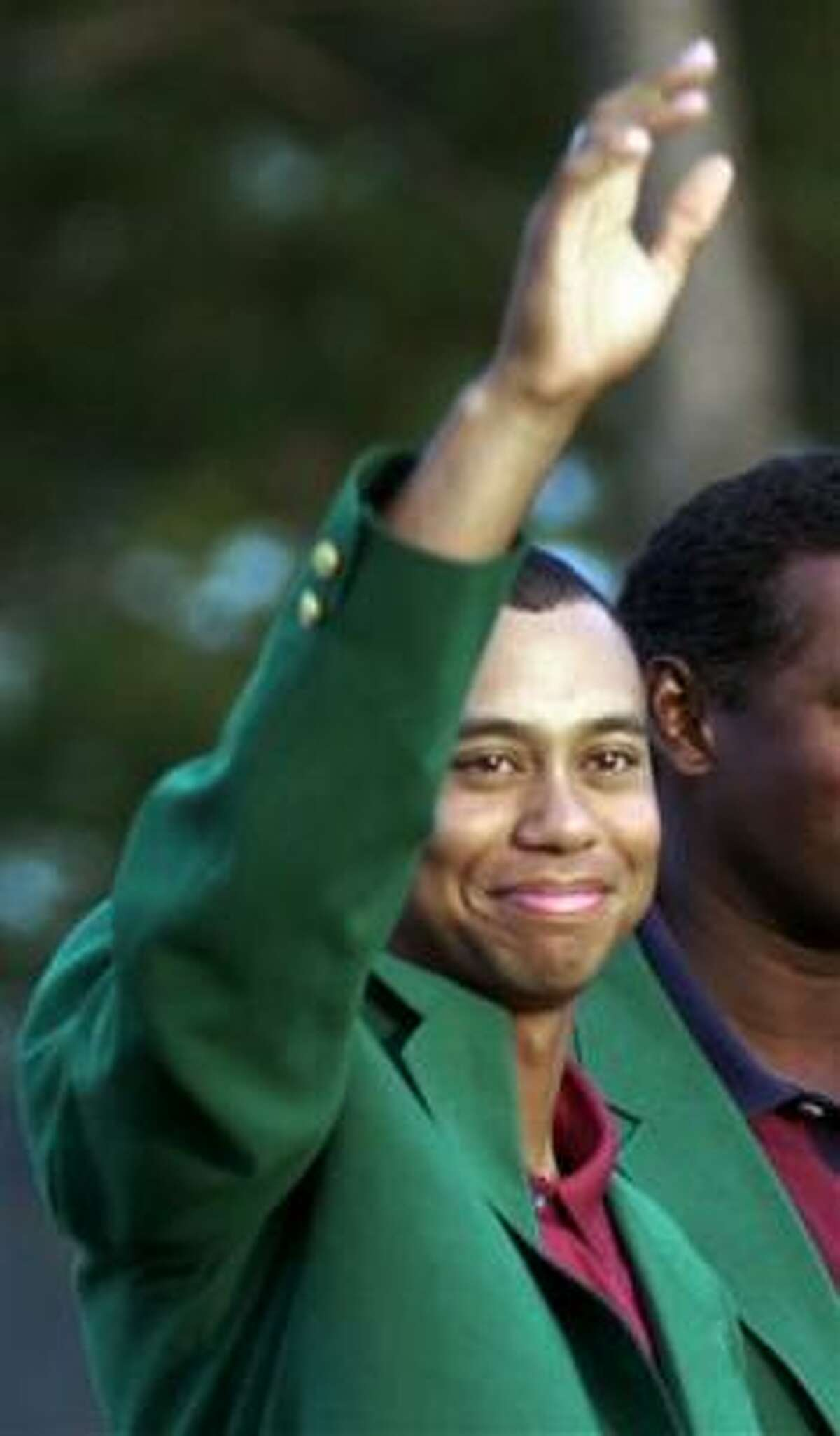 Tiger Woods, seen with the green jacket in 2001, has has not competed since Nov. 15 when he won the Australian Masters for his 82nd victory worldwide.