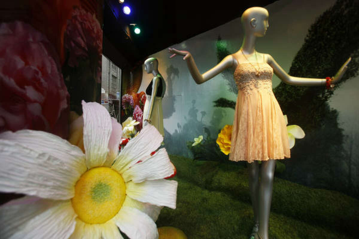 Clothes inspired by the Tim Burton movie Alice in Wonderland are displayed in the windows of Bloomingdales in New York.
