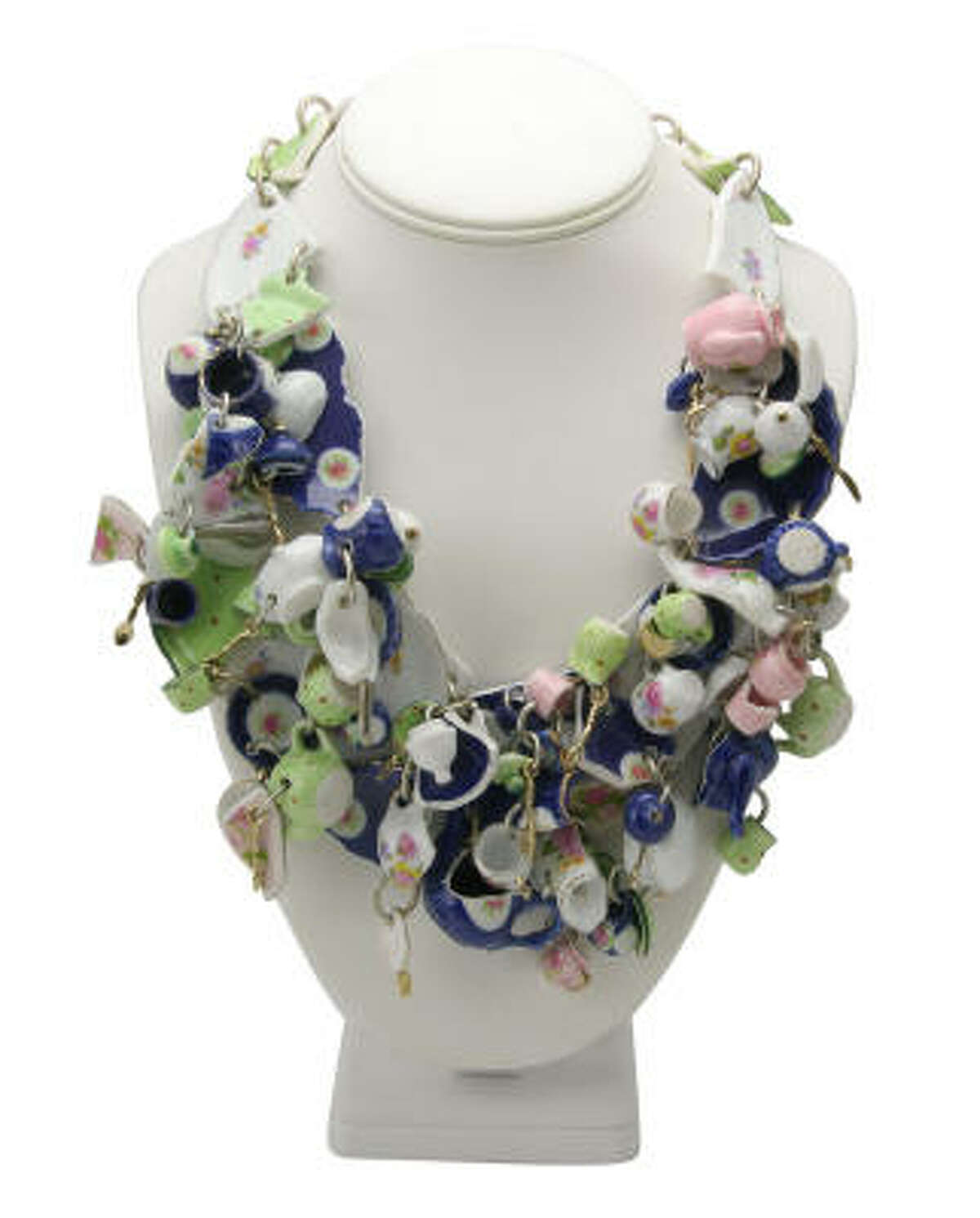 A necklace with multiple ceramic crockery charms by Tom Binns for Disney Couture, Alice in Wonderland line.