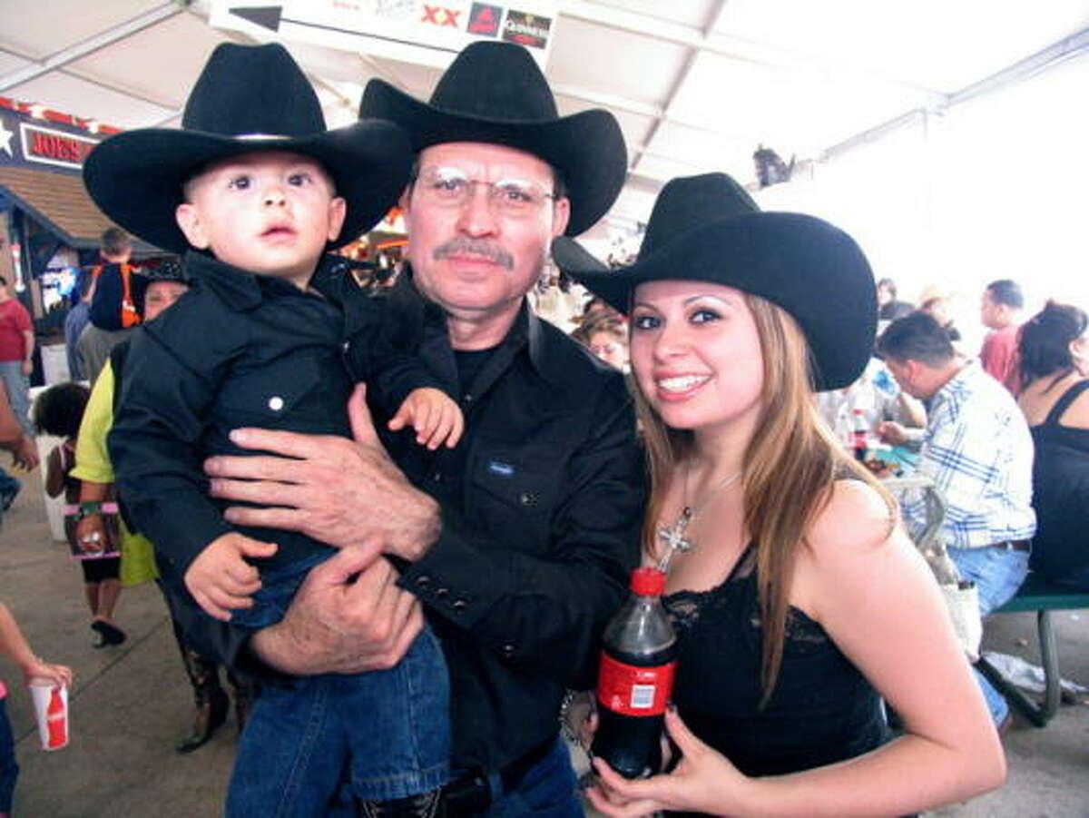 Omar Castro, from left, Omar and Melanie Deleon