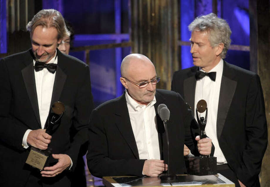 Inductees Mike Rutherford, Phil Collins and Tony Banks of Genesis speak onstage at Monday's induction ceremony. Photo: Michael Loccisano, Getty Images