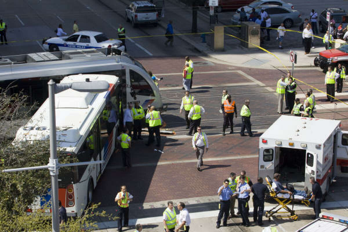Nineteen people were injured, none seriously, when a Metro bus and a light rail train collided in downtown Houston.