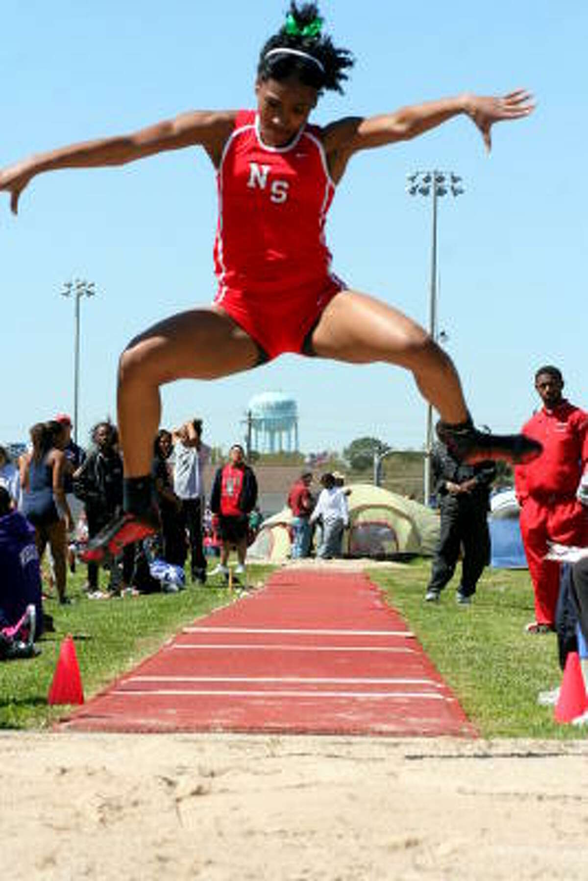 Noth Shore's Ashley Benjamine takes flight in the long jump.
