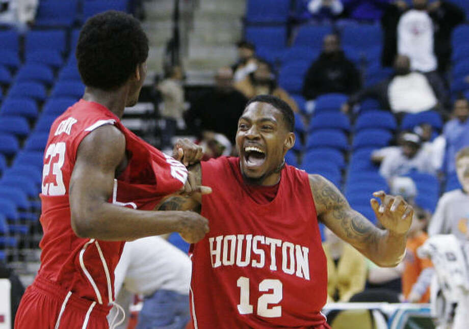 March 13: Houston 81, UTEP 73  Houston guard Aubrey Coleman, right, celebrates with teammate forwrd Bryce Clark after beating UTEP in the C-USA final. Photo: Sue Ogrocki, AP