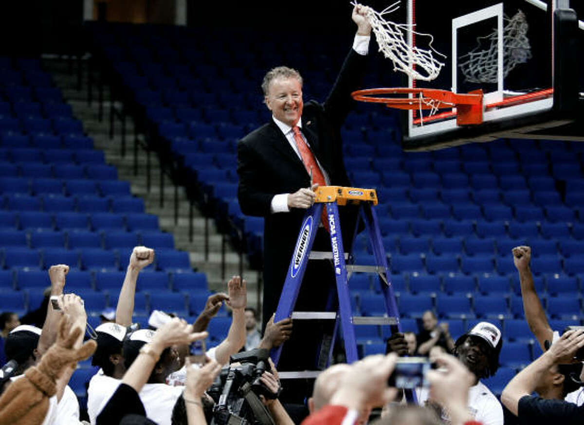 UH coach Tom Penders cuts down the net after leading the Cougars to an 81-73 win over UTEP in the Conference USA championship game Saturday in Tulsa, Okla. The Cougars advance to the NCAA Tournament for the first time since 1992.