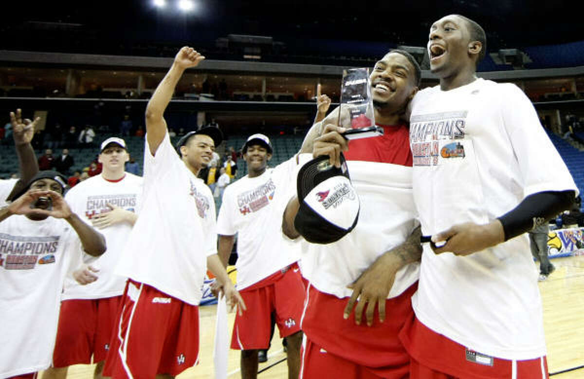 UH's Aubrey Coleman, second from right, and Kelvin Lewis, right, celebrate after Saturday's win.