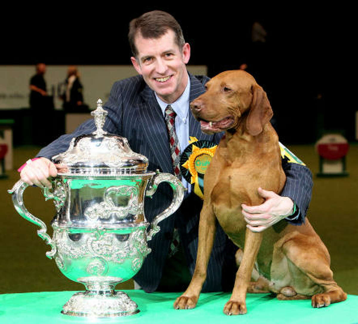 Yogi the Hungarian Vizsla and handler John Thirwell celebrate after winning 'Best in Show' at the 2010 Crufts dog show Sunday in Birmingham, England.