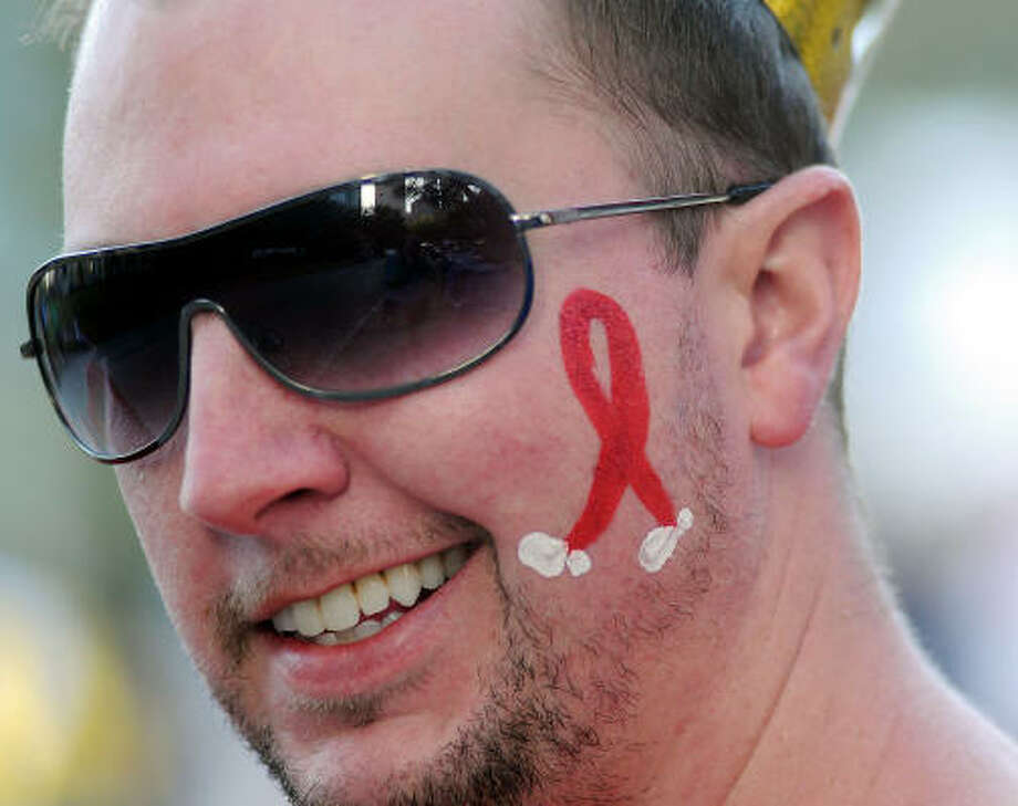 Josh Griffith, of Spring, chats with other team members before the annual AIDS Walk downtown. Photo: Dave Rossman, Chronicle