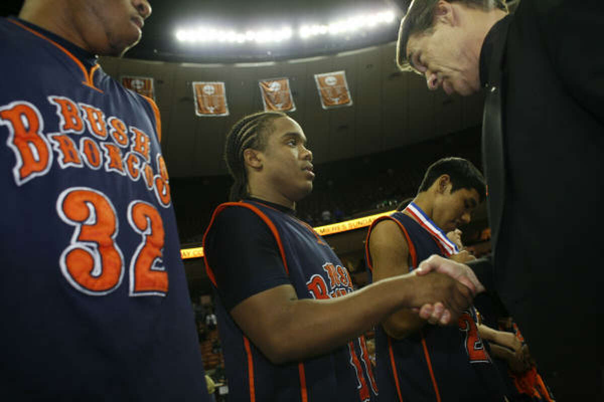 Bush's Travis Courtney receives a championship medal and handshake from Gov. Rick Perry.